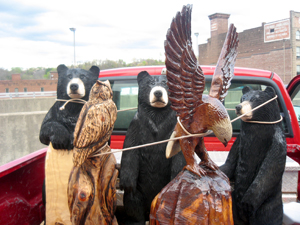 Chainsaw carvings on their way to the Urban Art Show