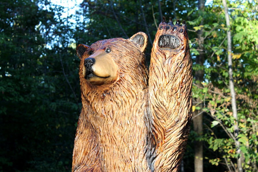 Waving brown bear welcomes guests at a B&B