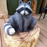 Raccoon wood sculpture
